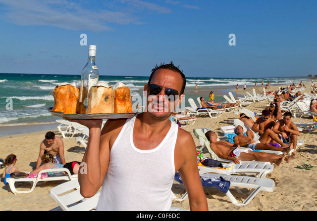 Barkeeper with coconuts and rum at Playa del Este, Santa Maria Del Mar, near Havanna Cuba - Stock Image