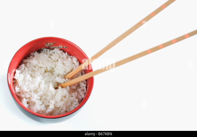 High angle view of a bowl of white rice with chopsticks - Stock-Bilder