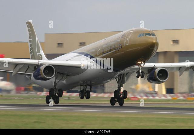 Gulf Air Airbus A340 313X landing at London Heathrow Airport UK - Stock Image