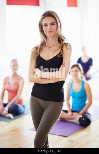 Portrait of female tutor in pilates class - Stock Image