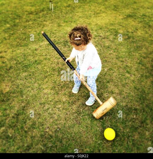 Toddler croquet - Stock Image