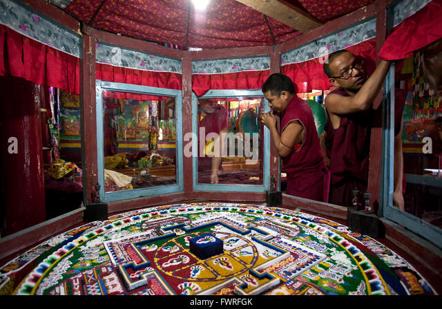 Buddhist monks finishing a sand mandala. Spituk Gompa. Ladakh. India - Stock Image