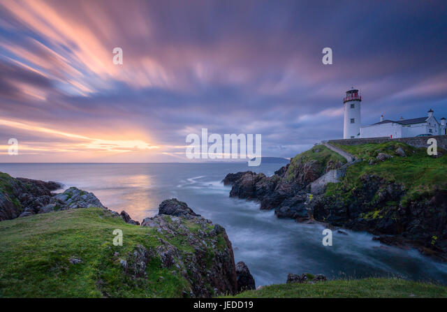 Donegal, Ireland. 24th June, 2017. Sunrise over Fanad Head Lighthouse Donegal Ireland Credit: John Potter/Alamy - Stock Image