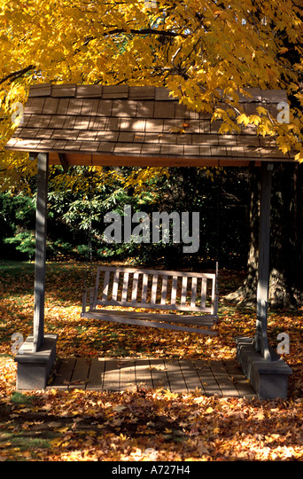 Fall colors autumn wooden swing - Stock Image