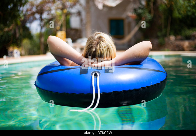 Person Laying By The Pool Stock Photos Person Laying By The Pool Stock Images Alamy