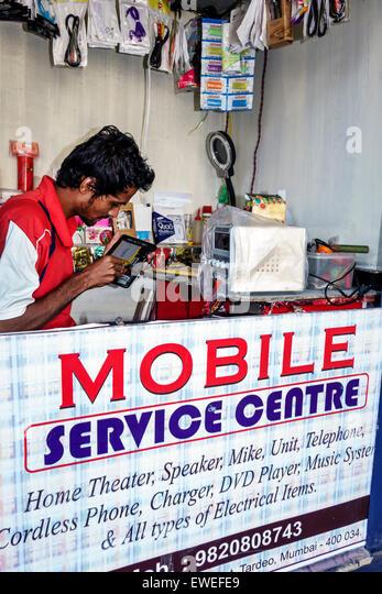 Mumbai India Indian Asian Tardeo Jehangir Boman Behram Road mobile service center centre repair smartphone tablet - Stock Image