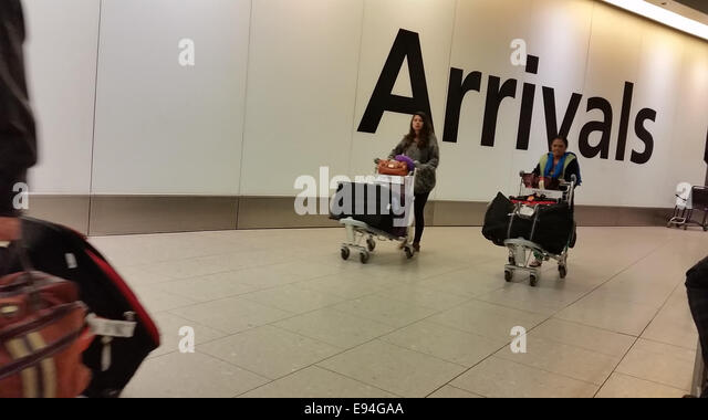 London, UK - 19 October 2014. People seen at the Heathrow Terminal 4 arrivals gate. Screening at Heathrow Terminal - Stock Image