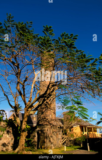 Old sugar mill tower, Caribbean Island of Nevis, Old Sugar Mill At Old Manor Estate & Hotel, blue sky background - Stock Image