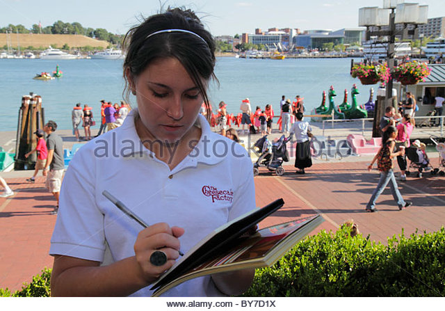 Baltimore Maryland Inner Harbor Patapsco River port waterfront Harborplace festival marketplace Cheesecake Factory - Stock Image