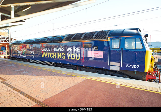 Diesel Locomotive with slogan designed to deter cable thieves Rugby Rail Station Warwickshire UK - Stock Image