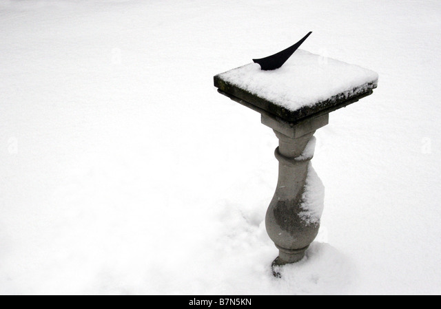 Sundial in the snow - Stock Image