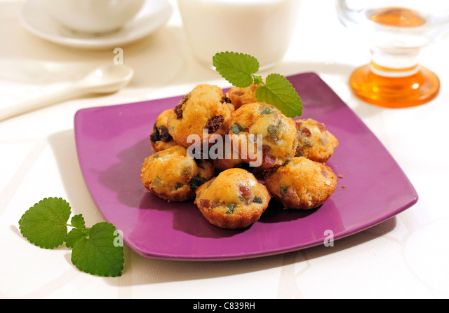Minimuffins with fruits. Recipe available. - Stock Image