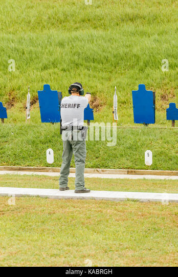 A sheriff's deputy shoots at the gun range at the law enforcement training center used by police officers, and - Stock Image