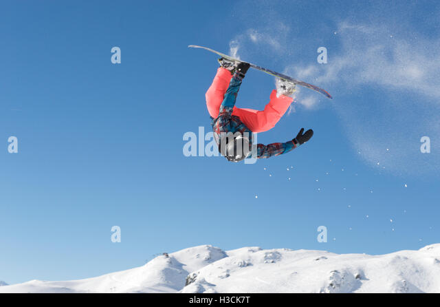 Front loop with a snowboard - Stock Image