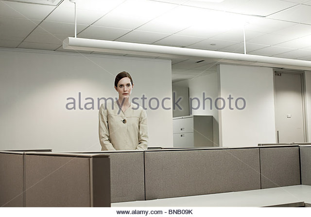 Businesswoman in empty office - Stock Image