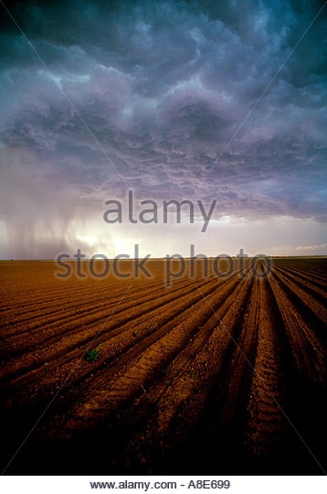 Severe Thunderstorm over freshly plowed field in in Hail County Texas - Stock Image