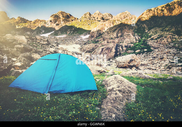 Mountains Landscape and tent camping Travel Lifestyle concept Summer vacations outdoor - Stock Image