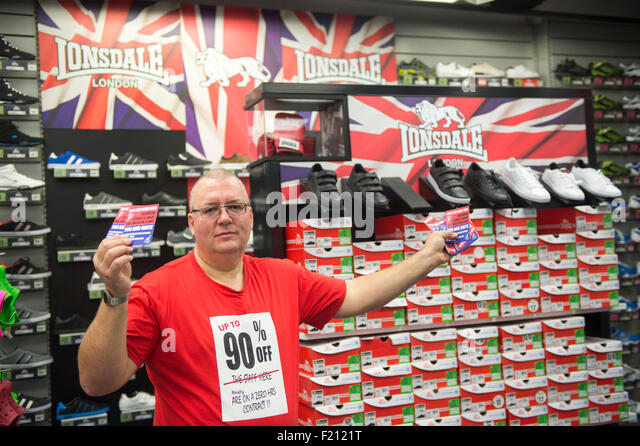 Shirebrooke, UK. 09th Sep, 2015. Jim Griffiths inside the Sports Direct Store to hand leaflets to members of staff - Stock Image