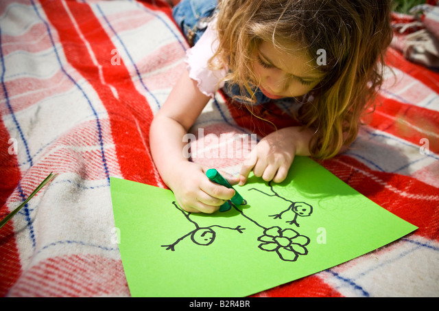 Girl colouring a drawing - Stock Image