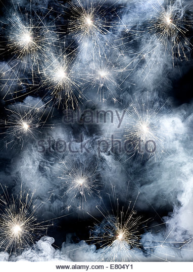 Smoke, sparks and sparklers on black background - Stock Image