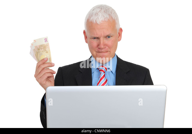 Businessman with Bills and Laptop on Sofa isolated - Stock Image