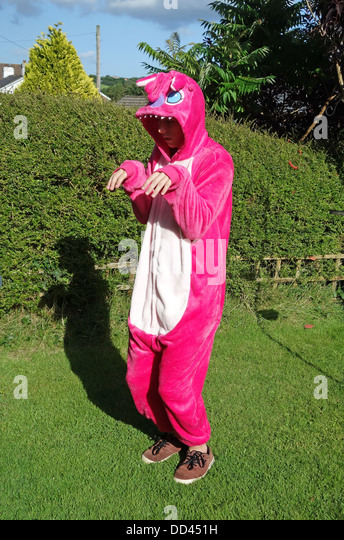 a teenage boy wearing a onesie of the character ' stitch ' from the ' lilo and stitch ' movie - Stock Image