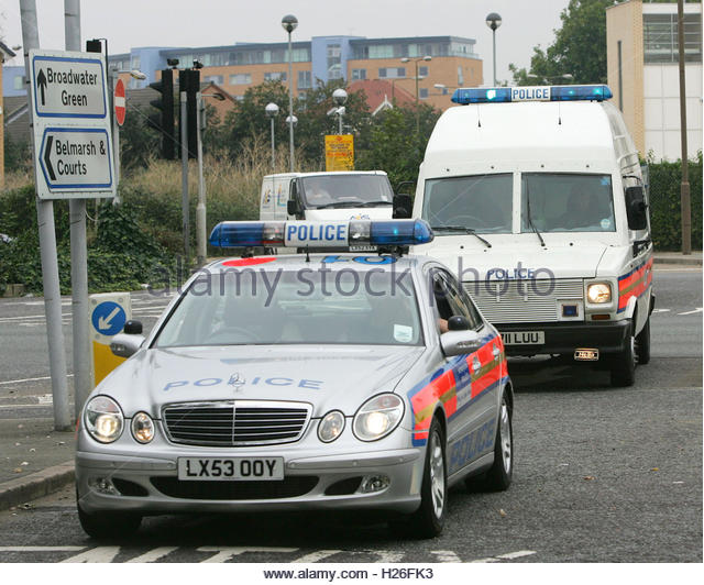 A police convoy believed to be transporting Ethiopian-born Briton Osman Hussein arrives at the top security Belmarsh - Stock Image