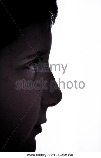 boy face in profile against white background - Stock-Bilder