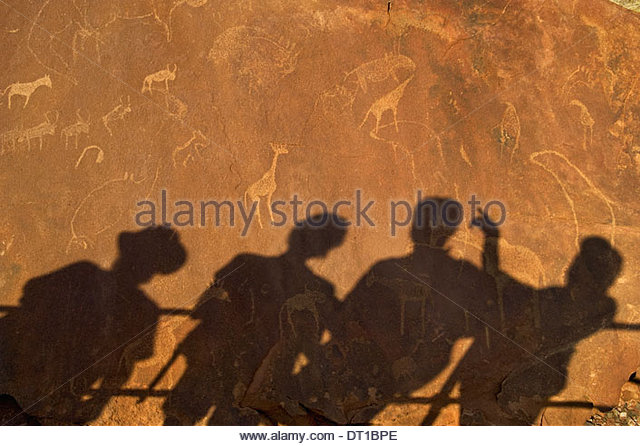 Uibasen Conservancy Damaraland Namibia. shadows tourists rock Twyfelfontein heritage site - Stock Image