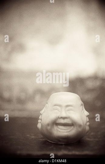 Strange Chinese multiple faced object. - Stock Image