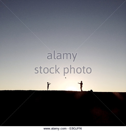 Father and son playing ball - Stock Image