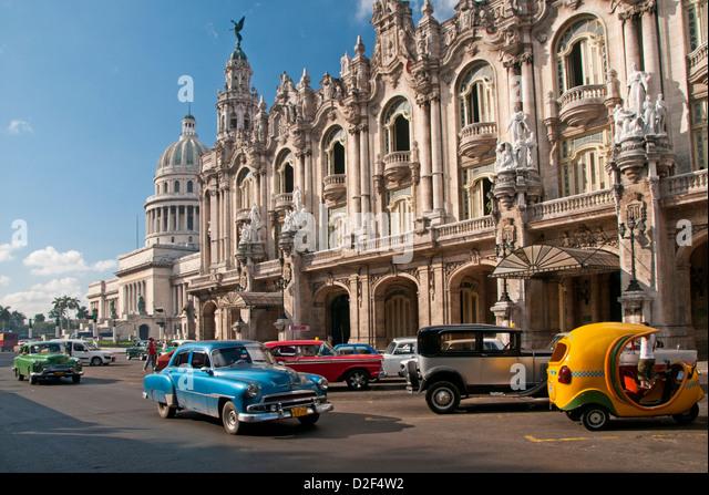 Classic 1950's American Cars Passing The Capitolio Building & Gran Teatro de la Habana, Paseo de Marti, - Stock Image