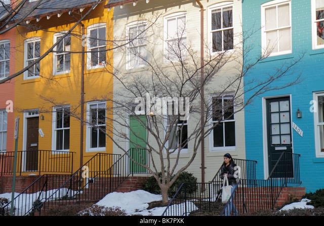 Washington DC Georgetown Prospect Street historic neighborhood row house college town gentrification Hispanic woman - Stock Image