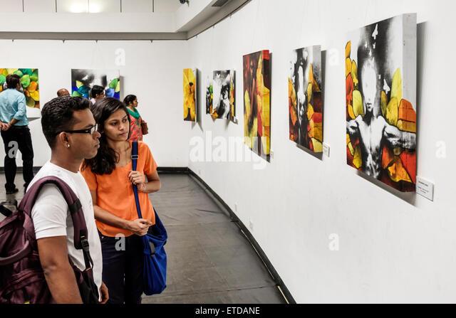 Mumbai India Indian Asian Fort Mumbai Kala Ghoda Jehangir Art Gallery contemporary paintings man woman couple looking - Stock Image