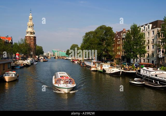Amsterdam Oude Schans Motelbaans toren canal boat - Stock Image