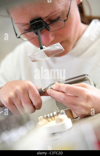 Work in a dental laboratory - Stock-Bilder