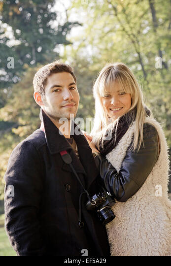 Portrait of happy young couple outdoors - Stock-Bilder