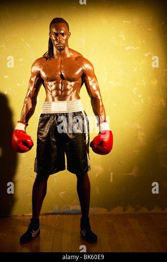 Boxer posing with boxing gloves - Stock Image