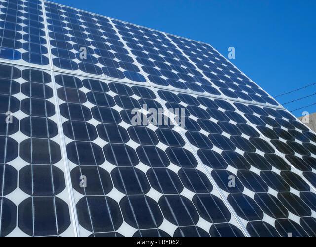 Solar panel photovoltaic cells array close up blue sky copy space Renewable energy clean eco-friendly power source - Stock Image