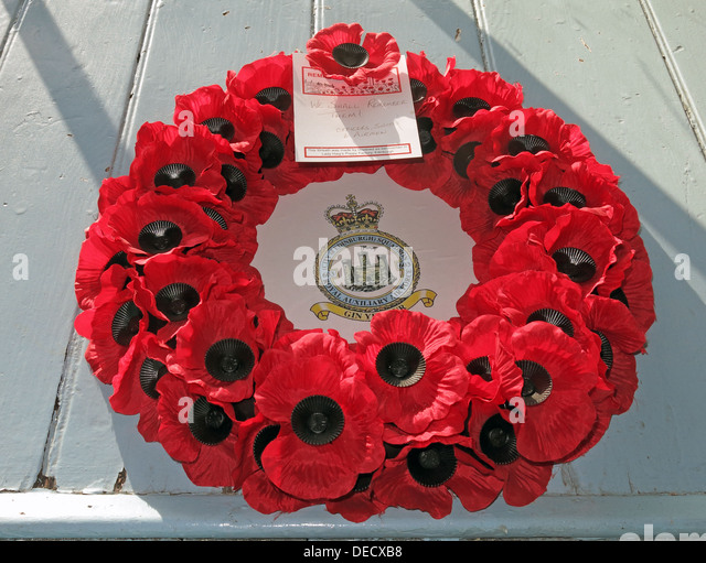 Red poppy wreath rememberance day Royal Auxiliary Air Force City of Edinburgh Squadron 603 at Canongate Kirk - Stock Image
