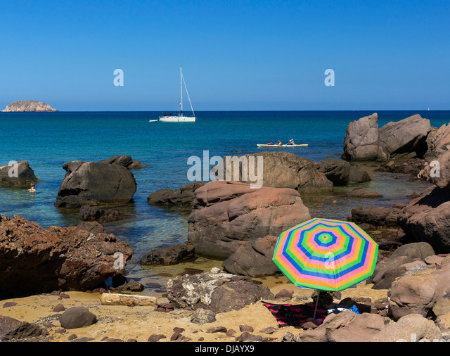 Rocky coast at Platja de Cavalleria Beach, Minorca, Balearic Islands, Spain - Stock Image