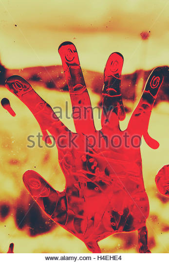 Bloody Halloween palm print left by a beseeching victim in the throes of death - Stock Image