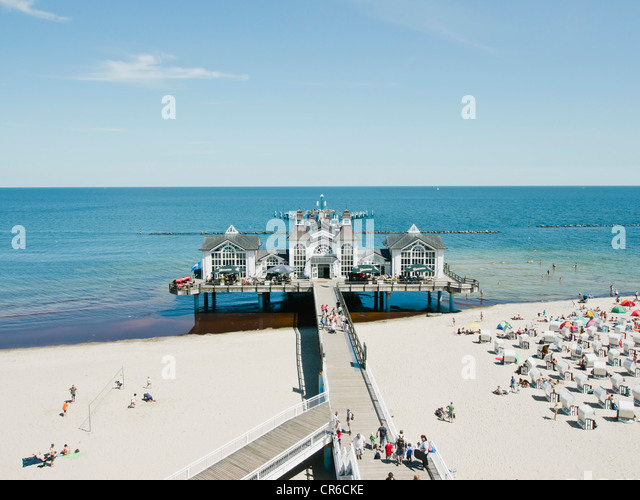 Germany,Ruegen, Binz,  People in beach booth at Island of Rugen - Stock Image