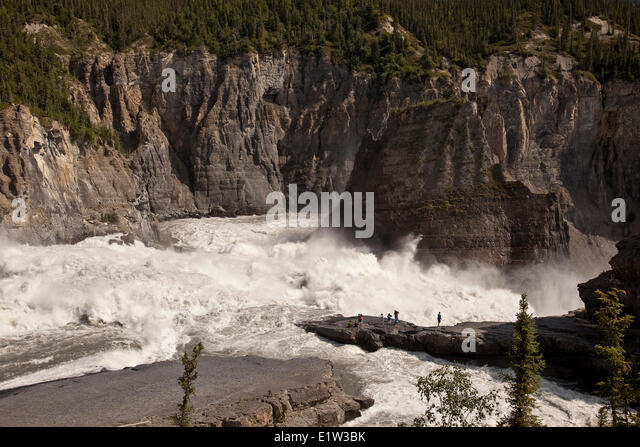 Group of people enjoy view at Sluicebox, Virginia Falls, Nahanni National Park Preserve, NWT, Canada. - Stock Image