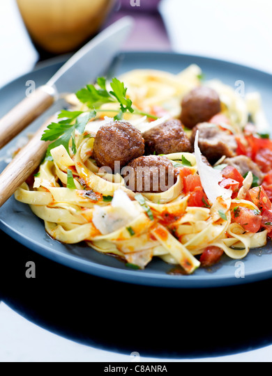 Beef meatballs with tagliatelles in tomato sauce - Stock Image