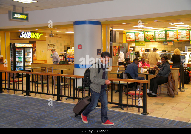 Virginia Sterling Washington DC D.C. Dulles International Airport IAD gate area concourse terminal Subway subs sandwiches - Stock Image