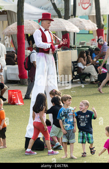 man-on-stilts-dressed-in-red-and-white-p