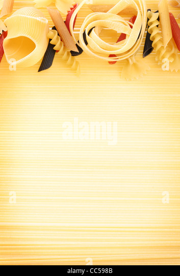 Uncooked pasta as a background. - Stock Image