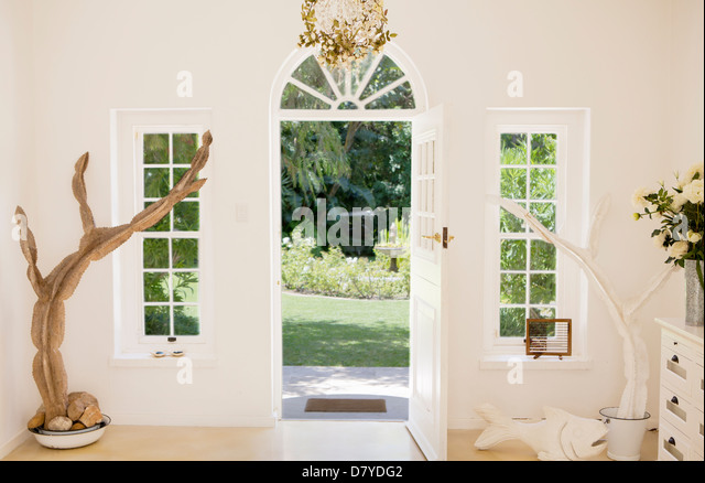 Open front door of modern house - Stock Image
