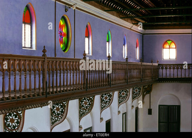 ornately railed corridor runs hall height protects access array painted windows stream Chettinad Tamil Nadu - Stock Image